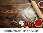 pizza dough with ingredients on ... | Shutterstock . vector #345777035