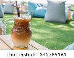 Ice Coffee In A Cup On Wood...
