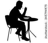 young man eating lunch in a... | Shutterstock .eps vector #345794975