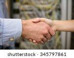technicians shaking hands in