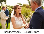 bride hugging father on wedding ... | Shutterstock . vector #345832025