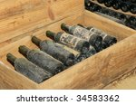 Old Bottles In Wine Cellar