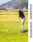 a golf player making a swing on ... | Shutterstock . vector #345839315