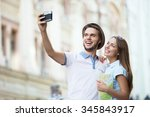 young couple making selfie... | Shutterstock . vector #345843917