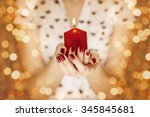 woman hands holding a candle... | Shutterstock . vector #345845681