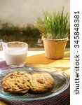 Small photo of chocolate chip cookie and almond cookie with milk in the morning