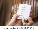 woman writing possible names... | Shutterstock . vector #345849917