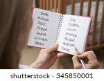 Woman Choosing Baby Names In...