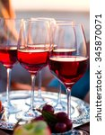 glasses of the red wine on the... | Shutterstock . vector #345870071