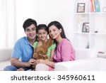 portrait of family with stuffed ... | Shutterstock . vector #345960611