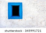 Blue Window On White Wall Of...