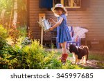 Child Girl Watering Flowers...