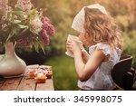 cute child girl on cozy outdoor ... | Shutterstock . vector #345998075