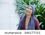 Portrait of female cancer survivor in headscarf