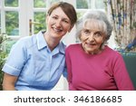 senior woman at home with carer | Shutterstock . vector #346186685