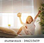 a nice girl enjoys sunny morning | Shutterstock . vector #346215659