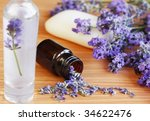 Lavender herb and bath focused on bottle with dried lavender flowers - stock photo