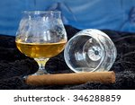 glass of cognac with a cigar on ... | Shutterstock . vector #346288859