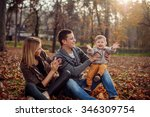 family having fun in a park | Shutterstock . vector #346309754
