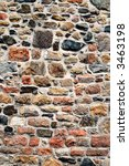 Large colorful old stone wall - stock photo
