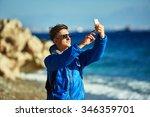 traveler with backpack making... | Shutterstock . vector #346359701