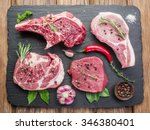 raw meat steaks with spices on... | Shutterstock . vector #346380401