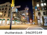 Stock photo vancouver bc canada nov cars passing by the corner of howe st and hastings st in 346395149