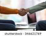 two men shaking hands in cafe | Shutterstock . vector #346621769