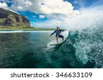 surfing in mauritius. muscular... | Shutterstock . vector #346633109