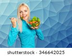 beautiful girl eating fresh... | Shutterstock . vector #346642025