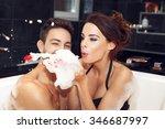 Happy Couple Blow Foam In...