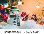 Snowman Stand Among Pile Of...