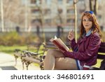 young woman reading a book in... | Shutterstock . vector #346801691