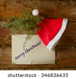 hat santa claus  a branch of... | Shutterstock . vector #346836635