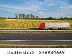 red truck driving on asphalt... | Shutterstock . vector #346934669