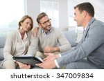 couple with realtor signing... | Shutterstock . vector #347009834