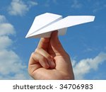 child hand with paper plane... | Shutterstock . vector #34706983