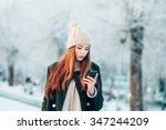woman in winter park talking... | Shutterstock . vector #347244209