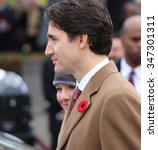 Small photo of OTTAWA, CANADA - NOVEMBER 11, 2015: New Canadian Prime Minister Justin Trudeau and wife, Sophie Gregoire Trudeau, place a wreath at Remembrance Day ceremonies in Ottawa.
