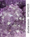 Small photo of Natural amethyst crystal background. Amethyst is a violet variety of quartz