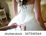bridesmaid is lacing white... | Shutterstock . vector #347540564
