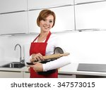 sweet cook woman wearing red... | Shutterstock . vector #347573015