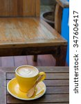 hot latte coffee in yellow cup | Shutterstock . vector #347606417