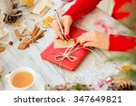 Woman Preparing Gifts For...