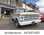 GRANTOWN ON SPEY, SCOTLAND - SEPTEMBER 6: Classic Ford F series pickup truck on September 6, 2015 in Grantown On Spey, Scotland - stock photo