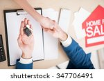 close up of arms of realtor and ... | Shutterstock . vector #347706491