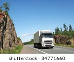 white truck on rocky highway | Shutterstock . vector #34771660
