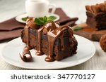 a piece of chocolate cake with... | Shutterstock . vector #347770127