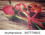 Two Red Roses With Gift