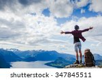 happy hiker with her arms... | Shutterstock . vector #347845511